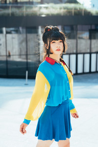 Young beautiful nonconformist asiatic woman posing outdoor in the city looking at camera - eccentric, stylish, hairstyle concept