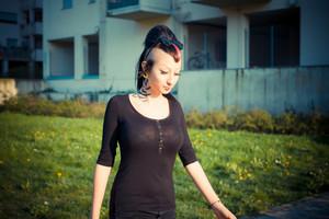 young beautiful punk dark girl in urban landscape