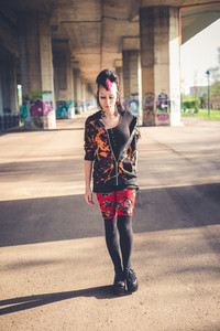 young beautiful punk dark girl in urban landscape