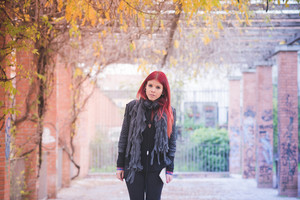 young beautiful red hair venezuelan woman lifestyle in the city of milan outdoor street