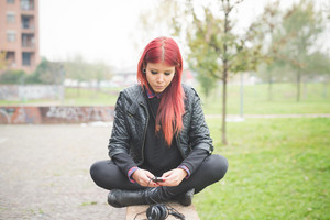young beautiful red hair venezuelan woman outdoor using smart phone hand hold - technology, social network, communication concept