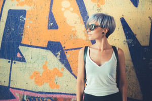 young beautiful short blue hair hipster woman in the city
