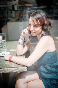young beautiful woman at the coffee