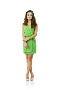 Young beautiful woman in green dress, studio shot, isolated on white background
