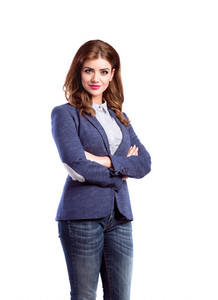 Young beautiful woman in jeans, white dotted blouse and blue jacket, studio shot on white background, isolated