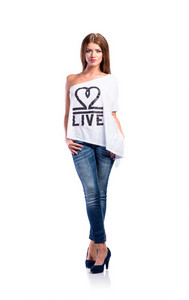 Young beautiful woman in white t-shirt, jeans and heels. Studio shot on white background, isolated.