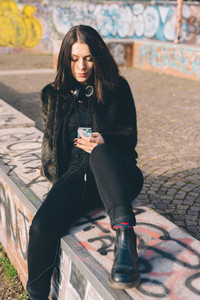 young beautiful woman usin smartphone in the city