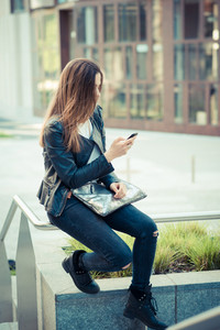 young beautiful woman using smart phone in the city