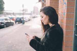 young beautiful woman using smartphone in the city