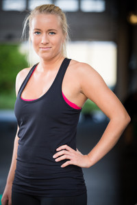 Young blonde woman in workout outfit