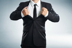 young businessman in superhero action with black suit