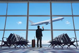 young businessman waving good bye at airport