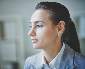 Young businesswoman with calm expression
