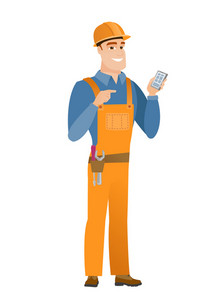 Young caucasian builder holding mobile phone and pointing at it. Full length of builder with mobile phone. Builder using mobile phone. Vector flat design illustration isolated on white background.