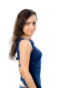 Young charming woman looking at camera over white background