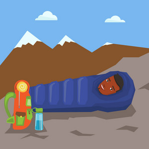 Young cheerful african-american man wrapped up in a mummy sleeping bag. Happy smiling man relaxing in a sleeping bag while camping in the mountains. Vector flat design illustration. Square layout.