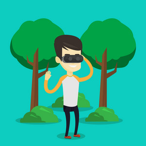 Young cheerful asian gamer wearing virtual reality headset in the park. Happy man using virtual reality glasses and playing videogame in the park. Vector flat design illustration. Square layout.