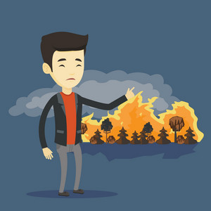 Young concerned asian man pointing at forest in fire. Frustrated man standing on the background of a big forest fire. Environmental destruction concept. Vector flat design illustration. Square layout.