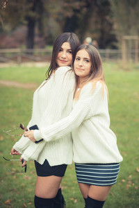 young couple beautiful women girls autumn outdoor