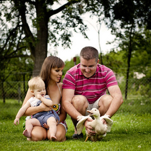 Young family is enjoying a day on the farm