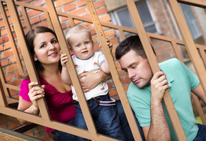 Young family with their son sitting outside on the stairs