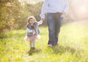 Young father during morning walk with his little daughter