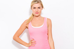 Young fit blonde woman in pink tank top