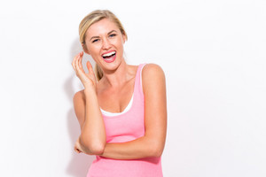 Young fit healthy woman in a tank top