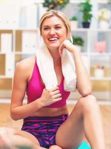 Young fit healthy woman with a towel