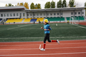 Young fit woman running on track