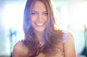 Young girl smiling charmingly at camera