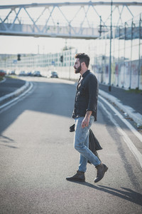 young handsome attractive bearded model man in urban context