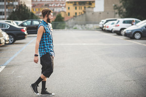 young handsome bearded hipster man in the city