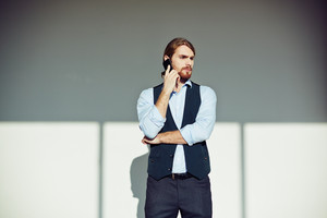 Young handsome businessman calling in isolation
