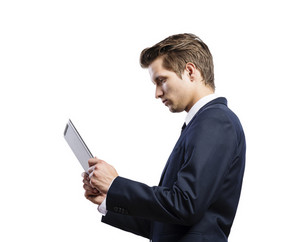 Young handsome businessman with tablet. Studio shot on white background.