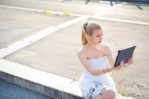 young handsome caucasian long blonde straight hair woman using tablet hand hold, talking selfie - multitasking, technology, social network concept