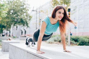 young handsome caucasian reddish straight hair woman doing stretching outdoor in the city - training, sportive, healthy concept