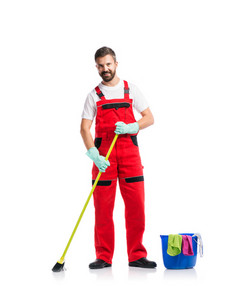Young handsome cleaner in red overalls. Studio shot on white background