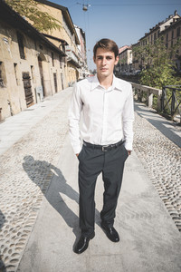 young handsome elegant blonde model man in the city