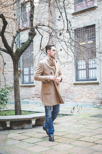 young handsome fashion model man outdoors