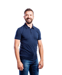 Young handsome hipster man in blue t-shirt. Studio shot on white background, isolated.