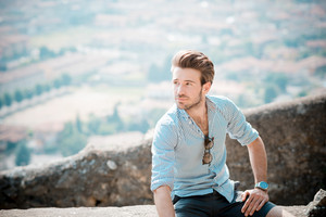 young handsome hipster modern man outdoor in summertime