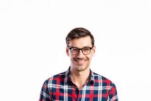 Young handsome man in checked red and blue shirt and black eyeglasses. Studio shot on white background, isolated.