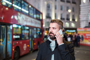 Young handsome man with smart phone in London city