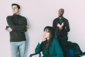 Young handsome multiethnic contemporary business people overlooking indoor - start up, business, millennials concept