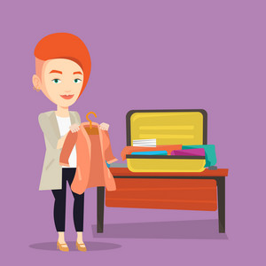 Young happy woman packing her clothes in an opened suitcase. Smiling caucasian woman putting a jacket into a suitcase. Woman preparing for vacation. Vector flat design illustration. Square layout.