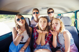 Young hipster friends on a road trip on a summers day