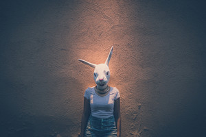 young hipster woman with rabbit mask in the city