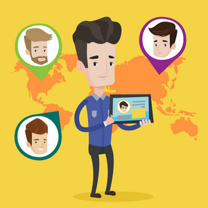 Young man holding tablet computer with social network user profile on a screen. Man standing on background of world map with avatars of social network. Vector flat design illustration. Square layout