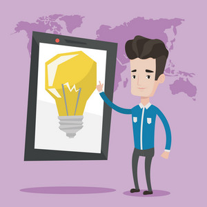 Young man pointing at a big tablet computer with a light bulb on a screen. Smiling man standing near tablet computer on a background with world map. Vector flat design illustration. Square layout.